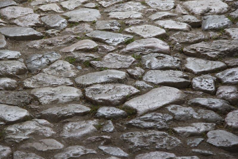 Achtergrond - het detail van a cobbled straat stock foto's