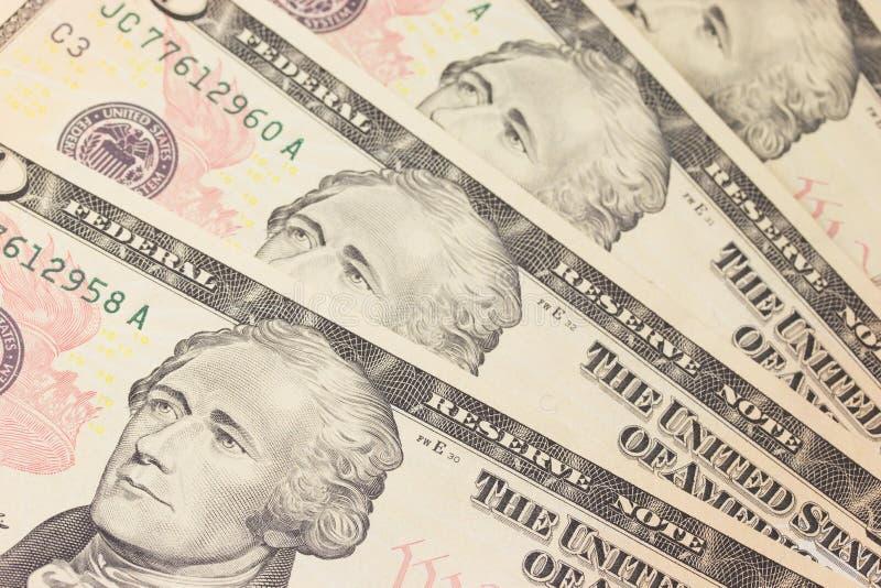 Achtergrond met geld de V.S. 10 dollarsrekeningen stock afbeeldingen