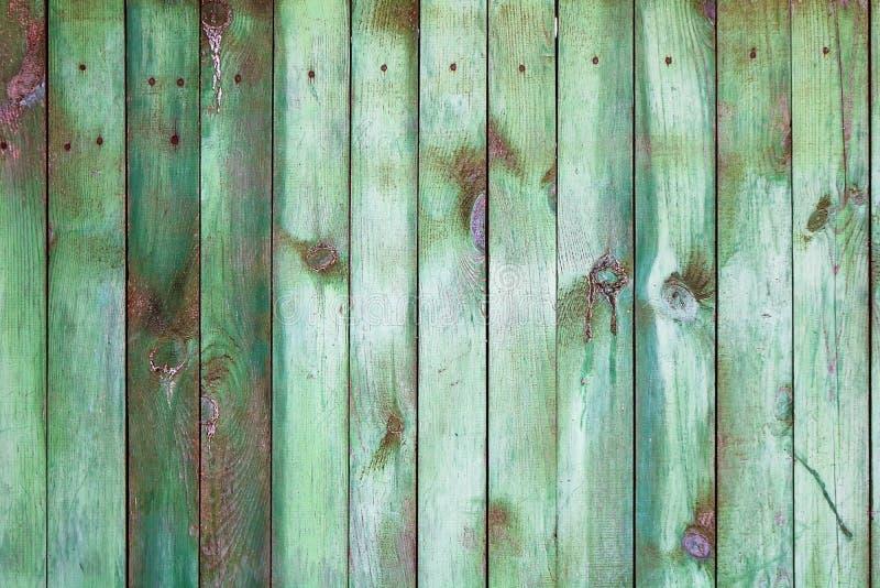 Achtergrond met groene houten omheining royalty-vrije stock afbeeldingen