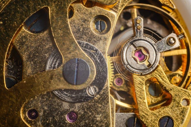 Achtergrond met metaaltandraderen een uurwerk Macro stock foto's