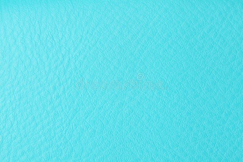 Achtergrond met textuur van azuurblauw leer stock afbeelding
