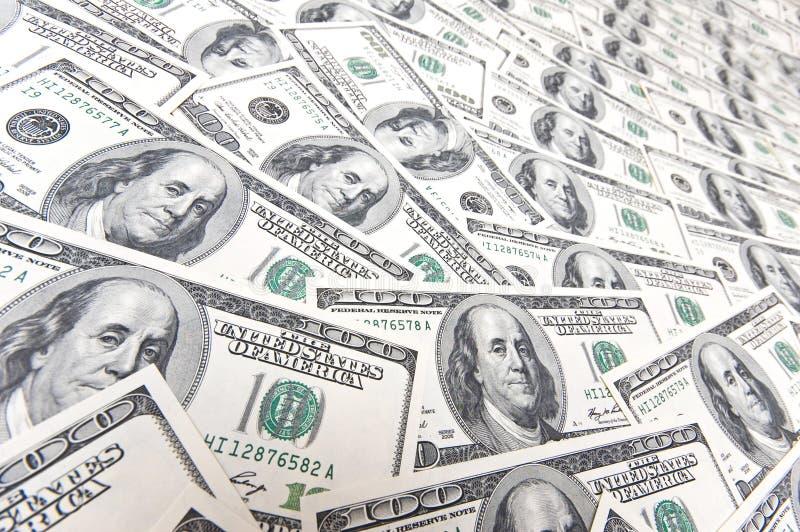 Achtergrond met vele Amerikaanse honderd dollarsrekeningen royalty-vrije stock afbeeldingen