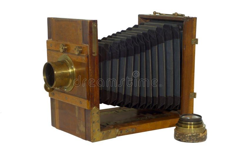 achtergrond: oude boeken op een plank en een vergrootglas stock foto's