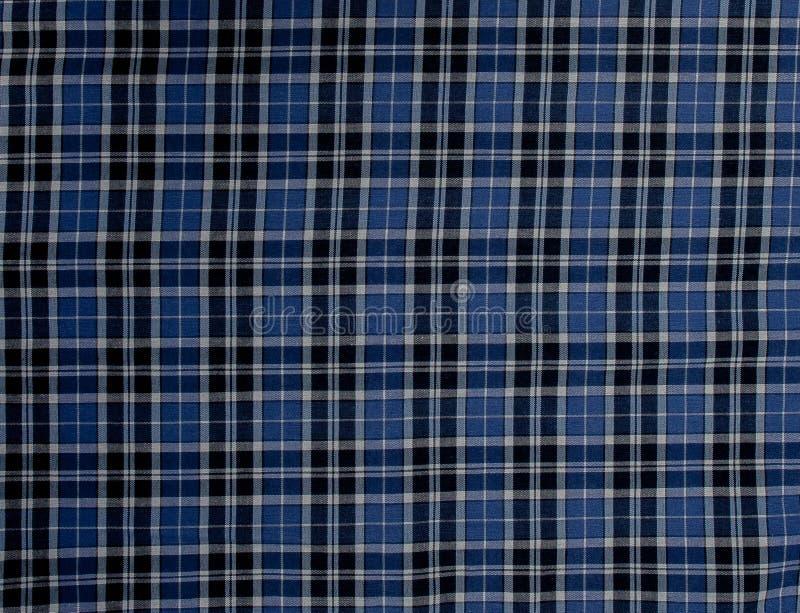 Achtergrond, stoffen geruite blauw en zwart Patroon Klassieke de stijlachtergrond van het land royalty-vrije stock afbeeldingen