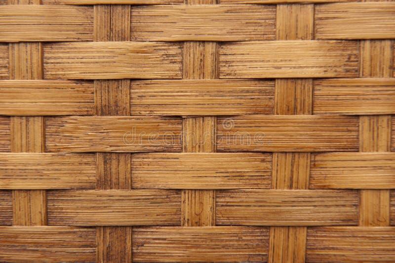Achtergrond textuur van lichtbruin geweven bamboe stock afbeeldingen