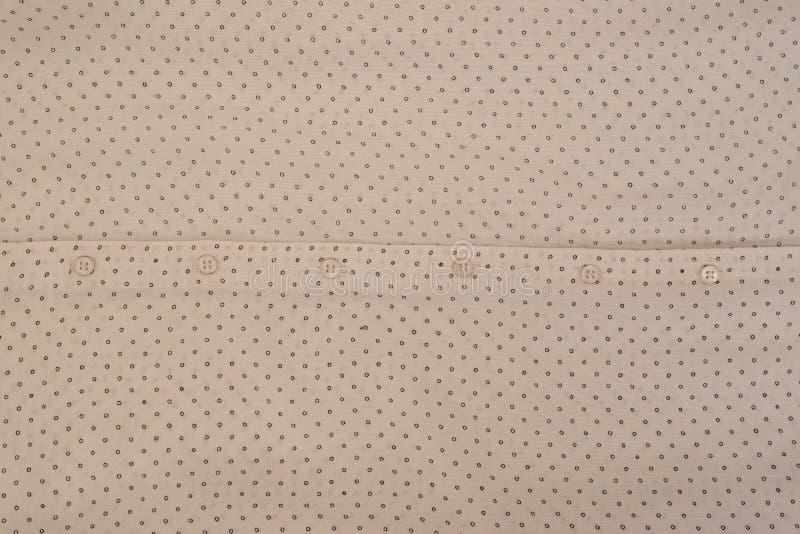 Achtergrond van beige stof met knopen Close-up stock foto