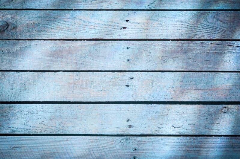 Achtergrond van blauwe houten raad stock foto's