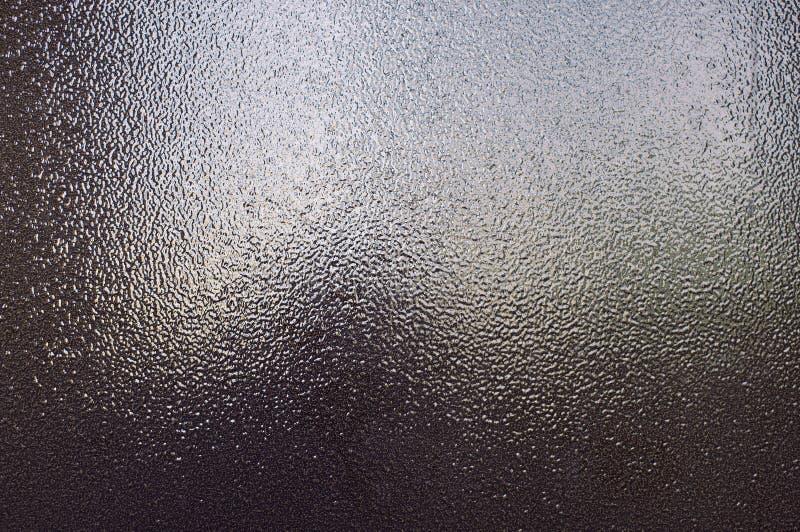Achtergrond van bruin brons geweven metaal dat in het licht schittert royalty-vrije stock afbeelding