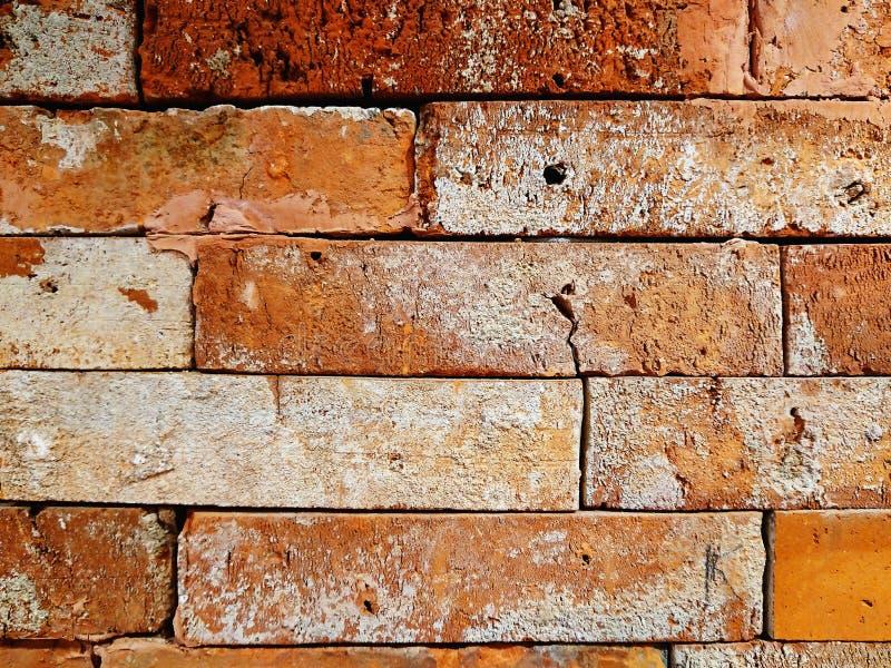 Achtergrond van de barst de rode bakstenen muur royalty-vrije stock foto's