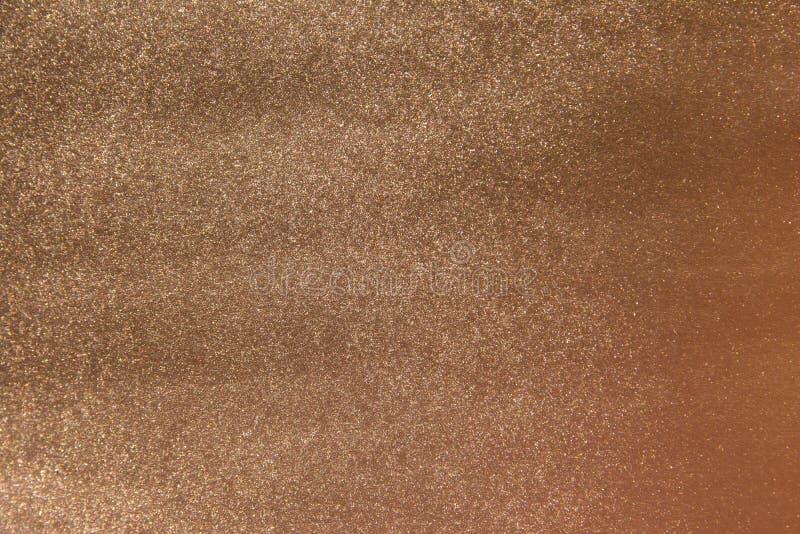 Achtergrond van de brons de glanzende metaaloppervlakte De donkere achtergrond van de kopertextuur royalty-vrije stock afbeelding
