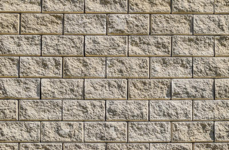 Achtergrond van de muur van witte baksteen gele beige baksteen De textuur van de baksteen De achtergrond van de bouw Kleine punte royalty-vrije stock afbeelding