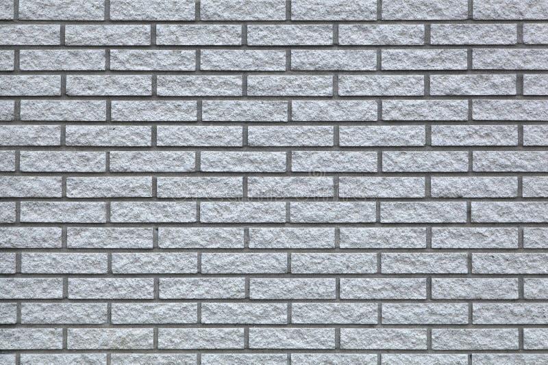 Achtergrond van grijze bakstenen muurtextuur stock foto