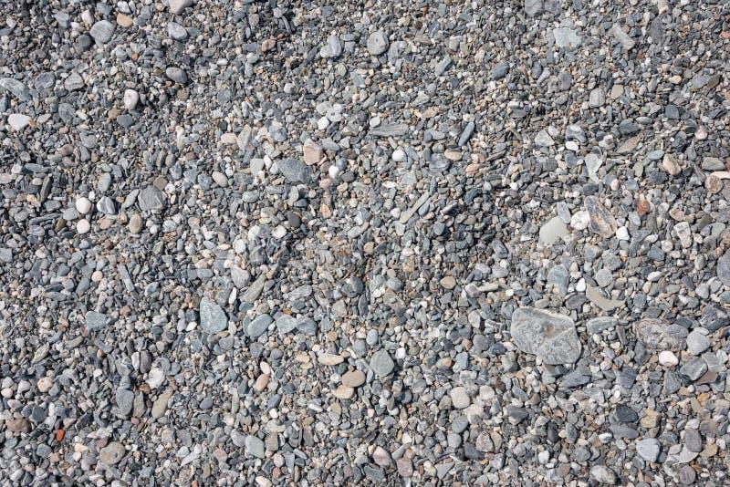 Achtergrond van grijze kiezelstenen wordt gemaakt die stock afbeeldingen