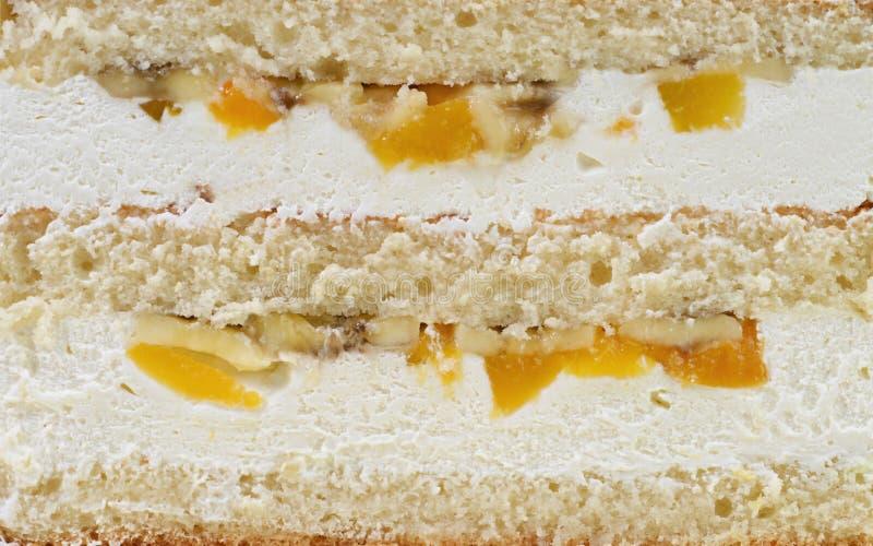 Achtergrond van heerlijke lagen van cake met vruchten royalty-vrije stock foto