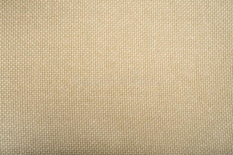Achtergrond van het de textuurclose-up van de wol de beige stof royalty-vrije stock fotografie