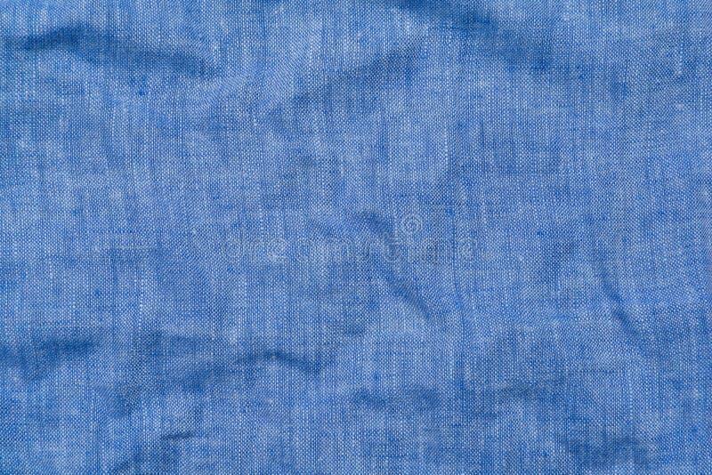 Achtergrond van het lichtblauwe linnenweefsel, verfrommeld stock afbeelding