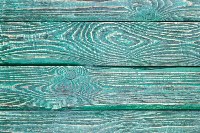 Achtergrond van houten textuurraad met de rest van de oude groene verf stock foto's