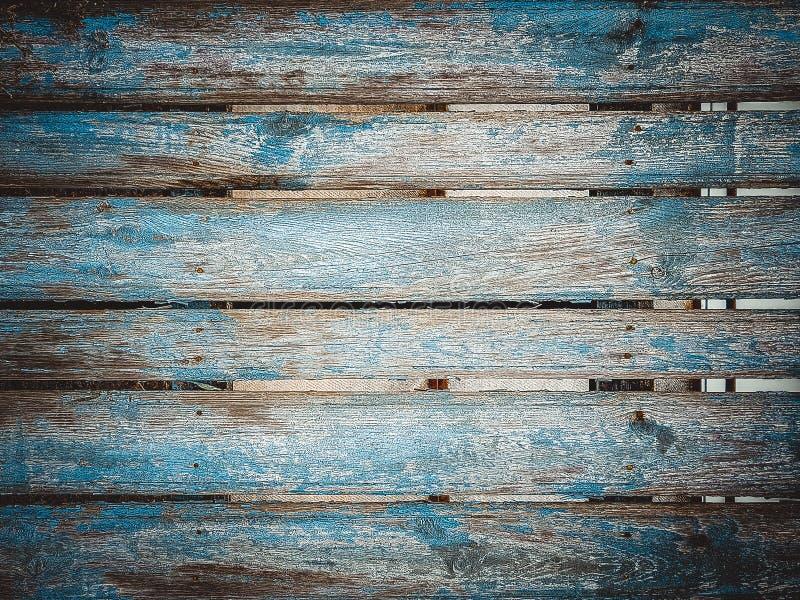 Achtergrond van indigo de blauwe houten planken Kleurrijke die omheining tegen tijd is verslechterd royalty-vrije stock fotografie