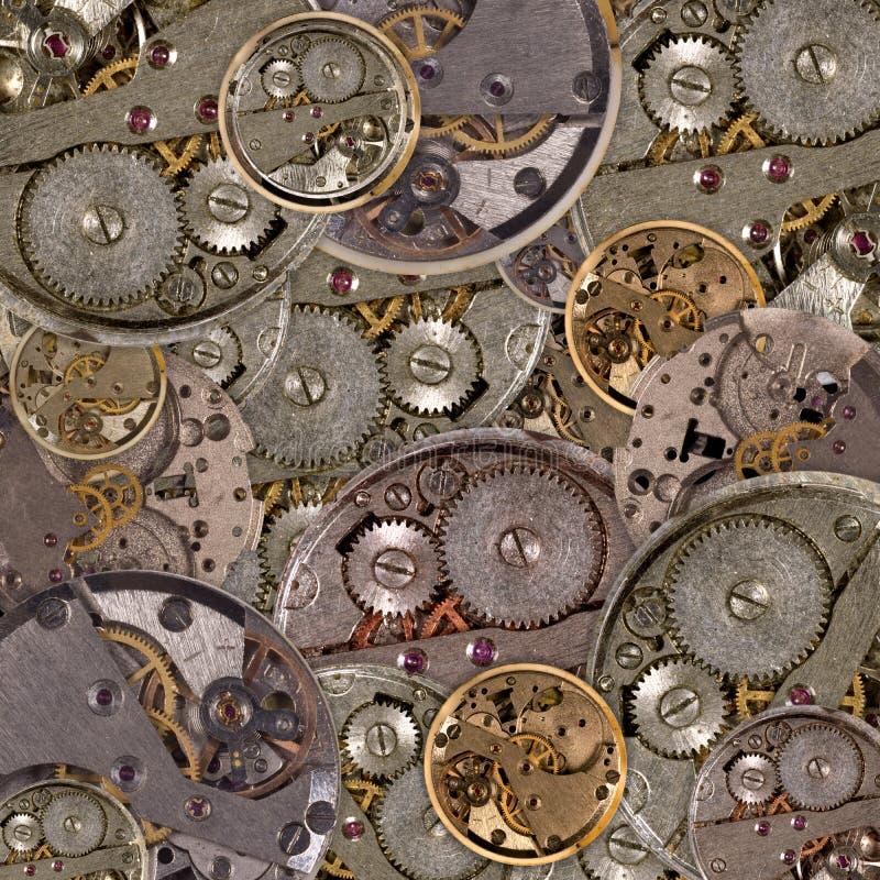 Achtergrond van klokmechanisme met toestellen stock fotografie