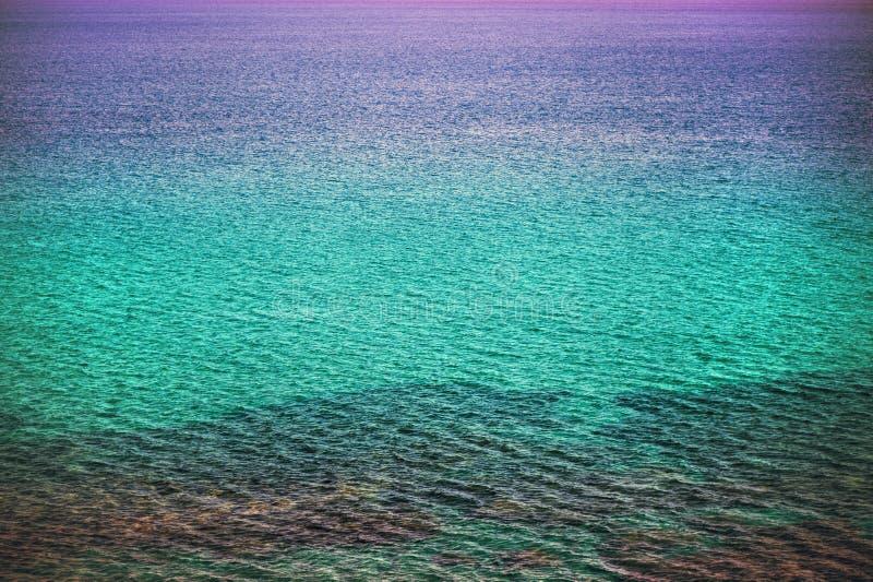 Achtergrond van oceaan en textuurzeewater op zonsondergang verschillende kleur stock foto