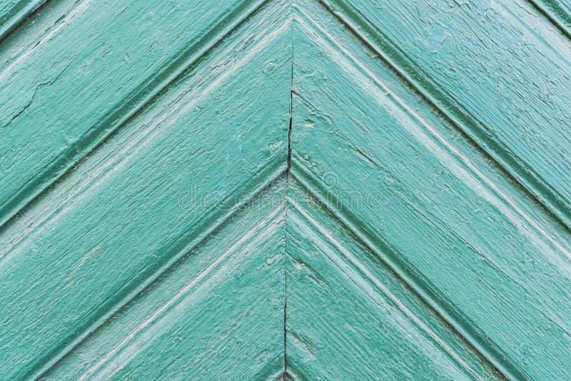 Achtergrond van oud geschilderd groen raads Driehoekig patroon naar omhoog stock foto's