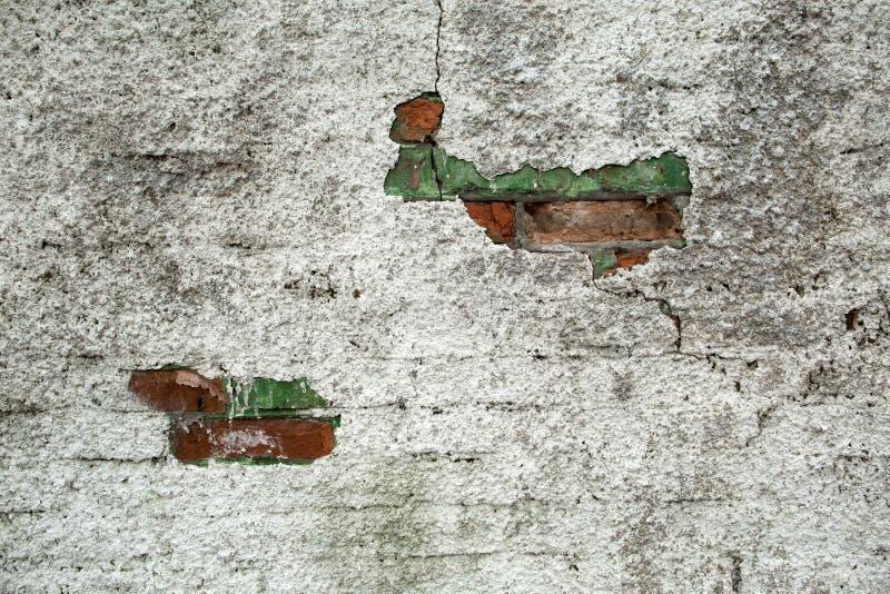 Achtergrond van oude bakstenen muur met afgeschilferd beton royalty-vrije stock foto's