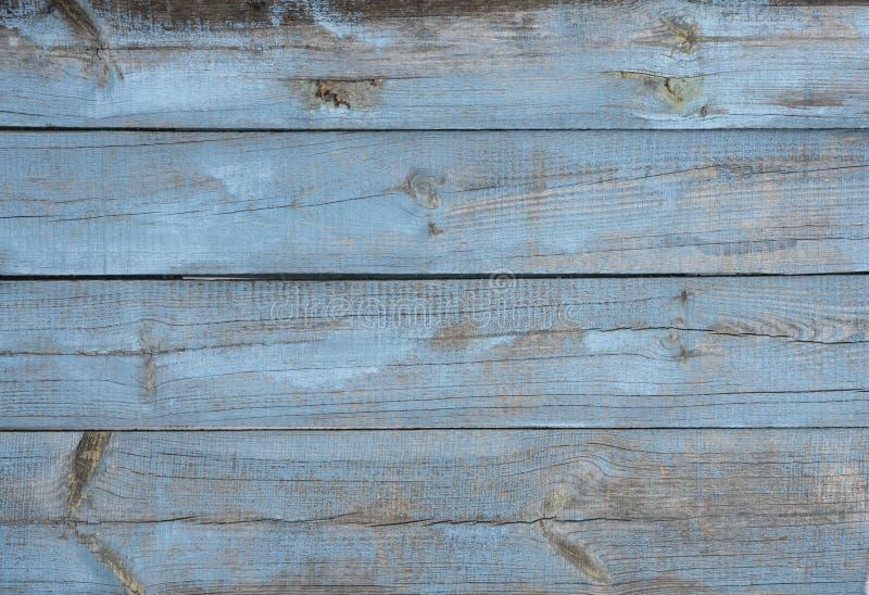 Achtergrond van oude houten raad die ongelijk in blauw wordt geschilderd royalty-vrije stock afbeeldingen