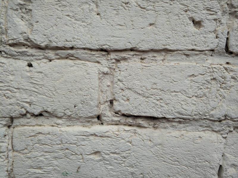 Achtergrond van oude witte baksteen Oude omheiningstextuur stock afbeeldingen