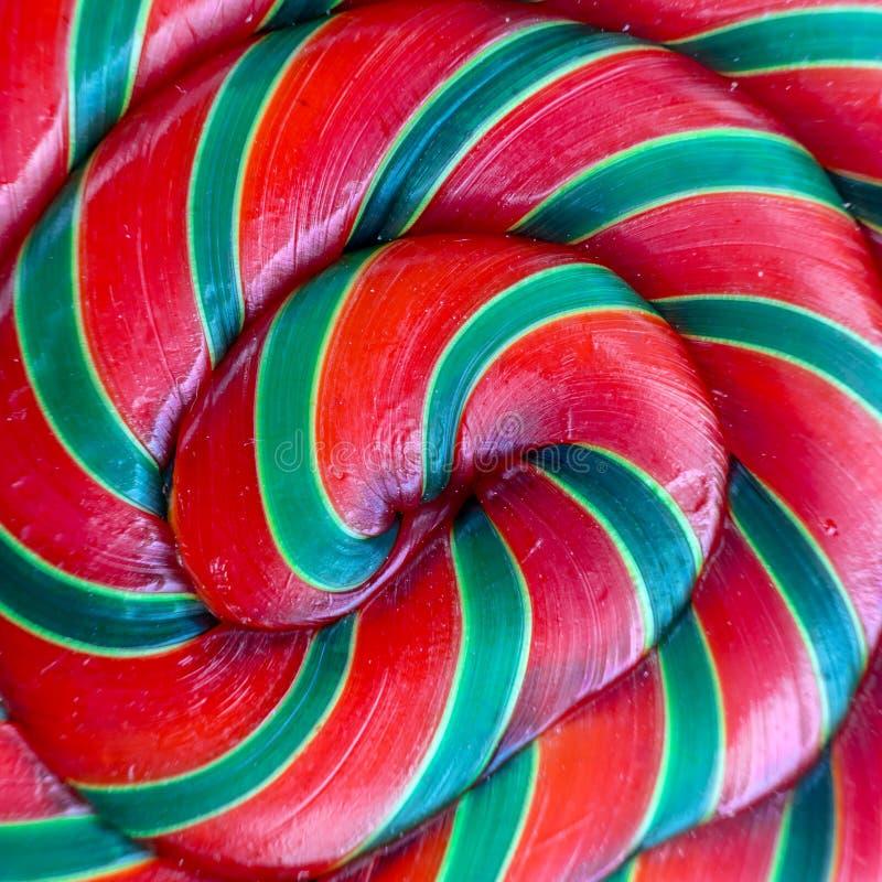 Achtergrond van rode en groene kleurrijke spiraalvormige lollyclose-up stock afbeelding
