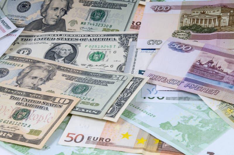 Achtergrond van roebels, dollars en euro stock afbeeldingen