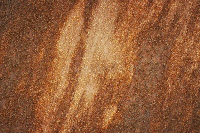 Achtergrond van roestige oppervlakte De roest behandelt ongelijk de oppervlakte en vormt een patroon stock foto
