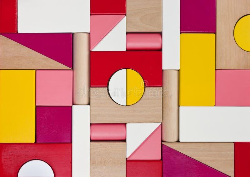Achtergrond van veelkleurige houten kinderenstuk speelgoed blokken royalty-vrije stock foto