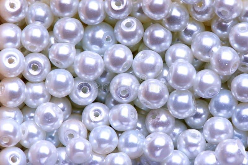 Achtergrond van wit decoratief parelsclose-up stock afbeelding