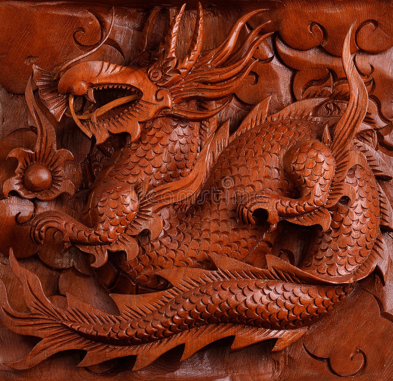 Achtergrondhoutsnijwerk van een draak royalty-vrije stock fotografie