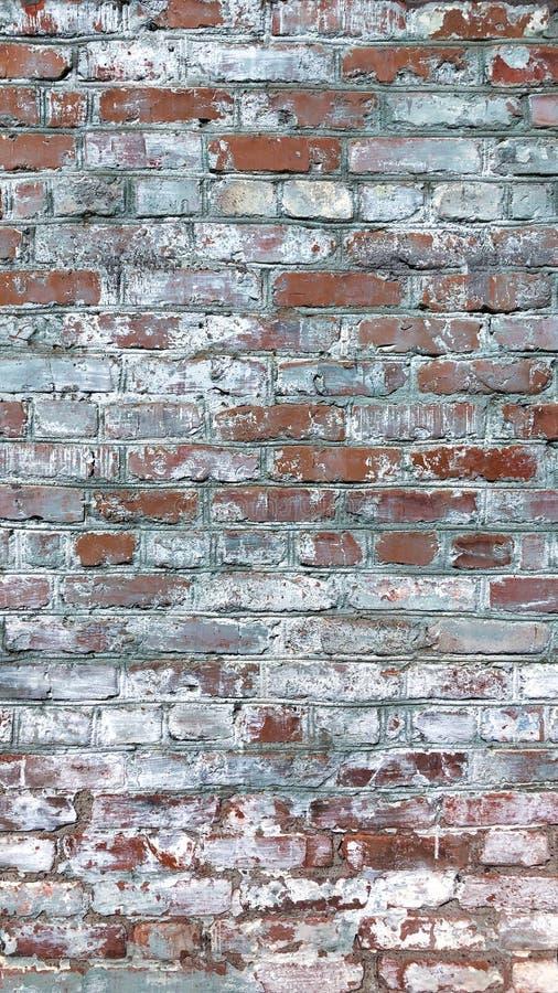 Achtergrondmuur van gescheurde baksteen stock foto's