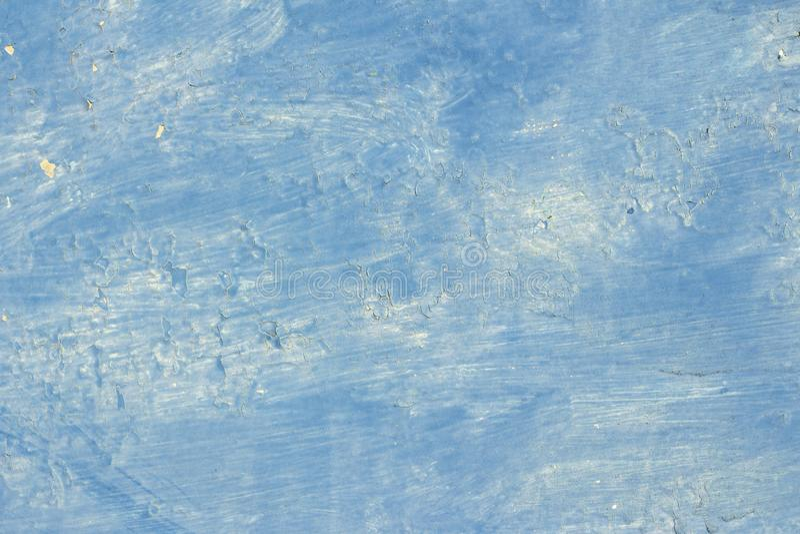 achtergrondtextuur blauwe verf met vlekken en het knallen in sommige plaatsen stock afbeeldingen
