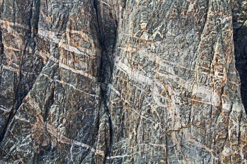 Achtergrondtextuur in Zwarte Canion bij Geschilderde Muurmening royalty-vrije stock afbeelding