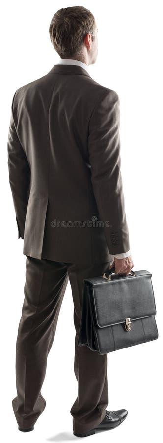 Achtermening die van zakenman zich met aktentas bevinden royalty-vrije stock afbeelding