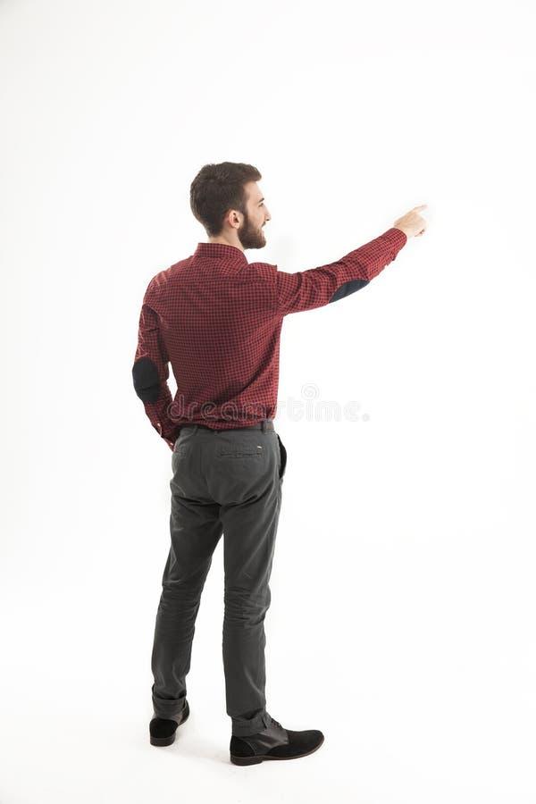 Achtermening - een succesvolle Manager van een het richten hand op de spatie royalty-vrije stock foto