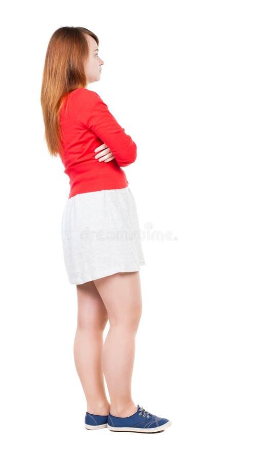 Achtermening van bevindende jonge mooie vrouw in kleding stock afbeeldingen