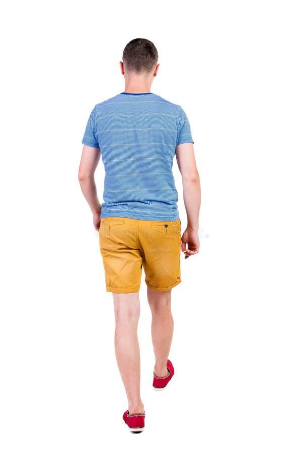 Achtermening van de gaande knappe mens in borrels lopende jonge kerel stock afbeeldingen
