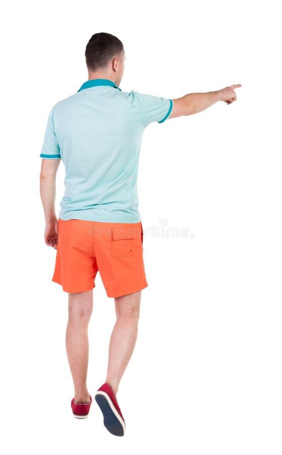 Achtermening van de gaande knappe mens in borrels lopende jonge kerel stock afbeelding