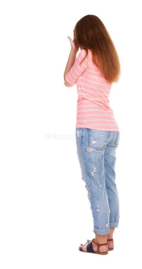 Achtermening van geschokte vrouw in broeken stock afbeelding