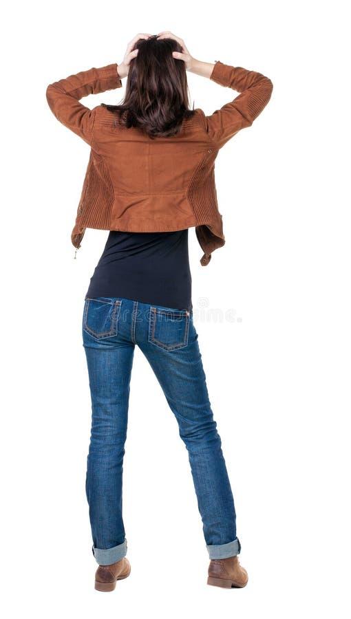 Achtermening van geschokte vrouw in jeans stock afbeeldingen
