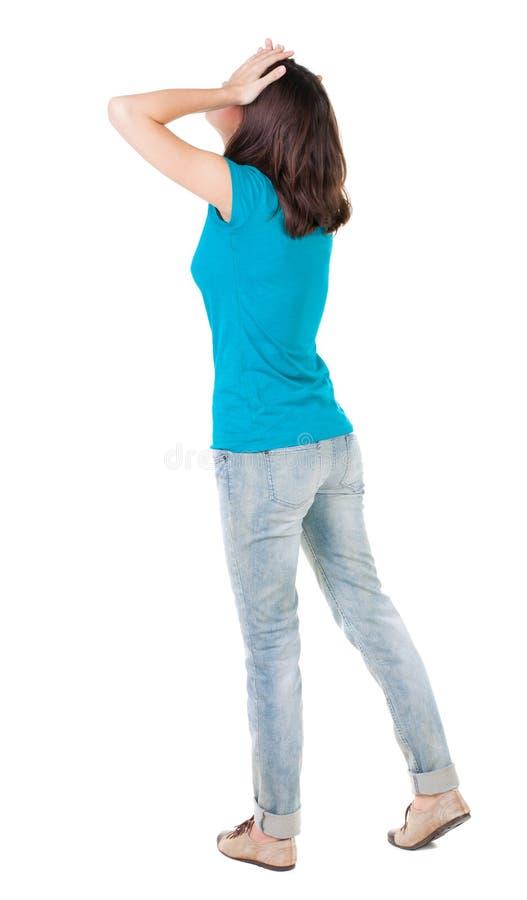 Achtermening van geschokte vrouw in jeans royalty-vrije stock foto's