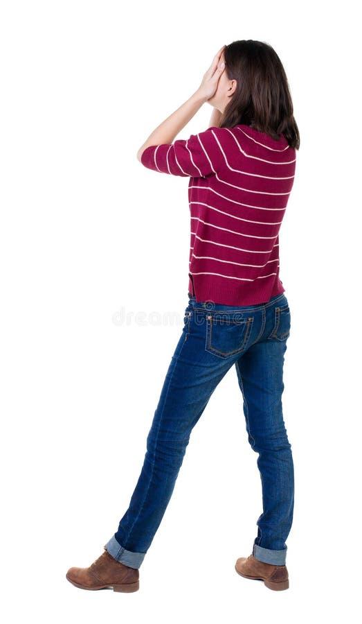 Achtermening van geschokte vrouw in jeans stock afbeelding