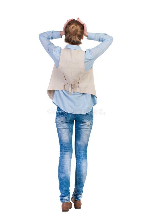 Achtermening van geschokte vrouw in jeans royalty-vrije stock foto