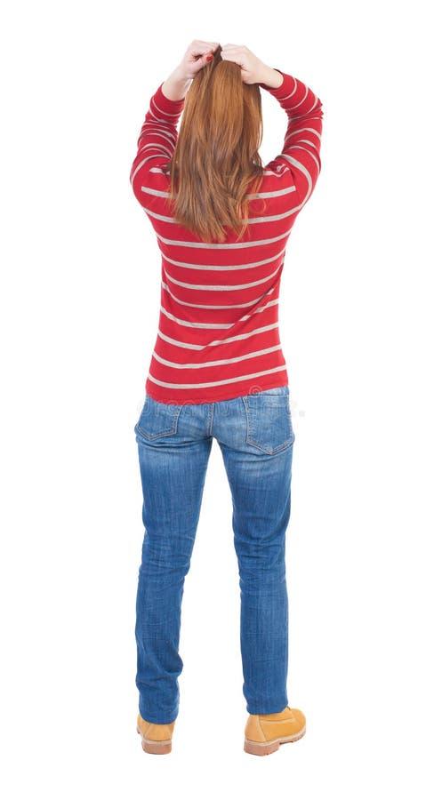 Achtermening van geschokte vrouw in jeans royalty-vrije stock afbeeldingen