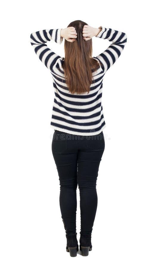 Achtermening van geschokte vrouw in jeans het meisje verborg zijn ogen achter hallo royalty-vrije stock foto