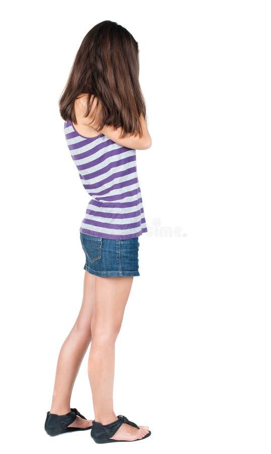 Achtermening van geschokte vrouw in jeanskleding stock afbeeldingen